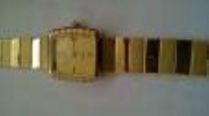 relogio marca Natan modelo voagem todo em ouro
